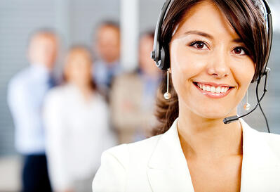 Female customer support operator with headset and smiling-1